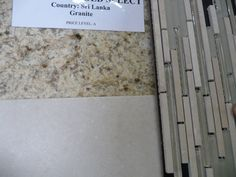 granite counters with floor tile and vanilla accents