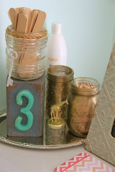 painted mason jars & number blocks  to hold supplies