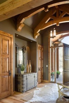 Beautiful rustic entry with trusses.  #entryway #foyers homechanneltv.com