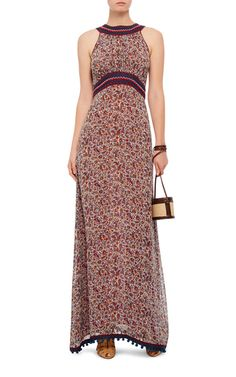 Exquisitely hand crafted in India, this **Talitha** maxi dress features an intricate micro floral print with a contrasting neck and waist detail.