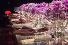 Mirror table with crystals and purple flowers