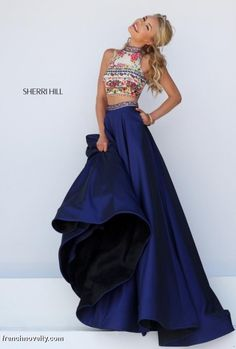 Size 4 Navy-Multi Sherri Hill 50080 Colorful Beaded 2pc Gown-  The high neck crop top of this lovely gown features intricate embroidery in a floral/Aztec pattern and glimmering beadwork that is sure to make your stand out from the crowd at your next black tie affair. As you twist and shout, spectators will take note of the crop top's enchanting keyhole back that shows just a peek of your lusciously toned skin. The skirt flows from the waist-cinching beaded belt to the floor length hemline.