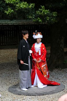 Traditional Japanese Wedding. Wealthier families frequently have two services. One in traditional clothing and a second in Western clothes. Traditional gowns are frequently in red or green since white is the traditional funeral color.
