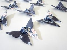 Navy origami butterflies as table toppers, table number embellishments, cake decor, and more!
