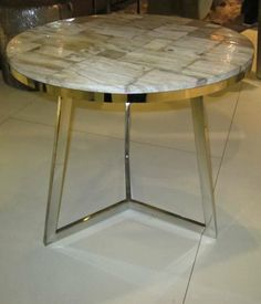 Indonesian prehistoric cream petrified wood slice top on modern tripod chrome base side table. www.balsamoantiques.com