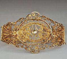 Armenian female bracelet. Late-Ottoman, 19th century, from the region of Van. Gilded silver filigree, decorated star rosettes adorned with silver beads. (Armenian Museum of France, Paris).