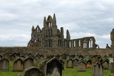 Whitby Abbey ruins in Whitby, England as seen from the St. Mary's Church cemetery nearby. Just over the hill is the North Sea.