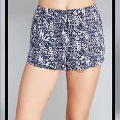 New floral high waisted shorts New with tags, navy and white floral high waisted shorts. Size medium, has an elastic waist band. Shorts