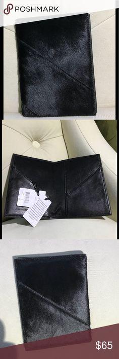 Diane von Furstenberg  (DVF) calf fur passport Black silky smooth calf fur. DVF high quality leather with Diane von Furstenberg embossed on interior .New with Tags. Diane Von Furstenberg Bags Wallets