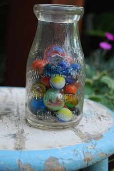 Antique marbles ~ I found most of mine while digging in the flowerbeds of my home. A family of boys used to live here!