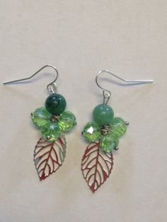 Green Dangle Earrings with Silver Leaf Charms by DayDreamingDecor, $10.00...maybe make it with the butterflies I have. :)