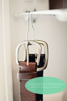 Hang shower rings from wire shelving to hold belts.