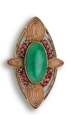 *A jadeite jade, garnet and plique-à-jour brooch, Louis Comfort Tiffany, circa 1910 centering an oval cabochon jadeite jade, within a surround of circular-cut garnets and accented with enamel detail; signed Tiffany & Co; mounted in eighteen karat gold