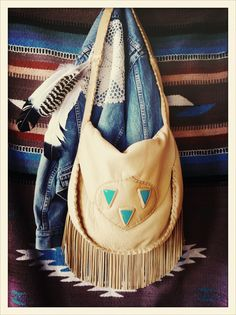 <<>> 'Canyon Song' by Three Arrows Leather. Golden leather whip stitched bag with hand cut fringe and turquoise triangle pieces inset. Sending six of these lovely ladies off to freepeople.com threearrowsleather.com