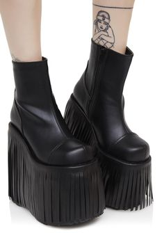 Demonia Dance Kraze Fringed Platform Boots ya can't fight the rhythm, bb, and why would ya want to? These dope ankle boots feature a smooth faux-leather construction, chunky platforms with wrap-around fringe detail that swishes N' swings when ya move and inner ankle zipper closures.