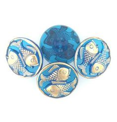 These buttons are hand pressed glass. Czech Glass Button Two Fish Blue and Gold 22mm 4 Pieces