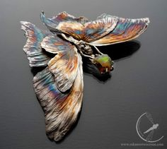 Emanation #SilverPin with double #butterfly wings and a raw piece of a beautiful…