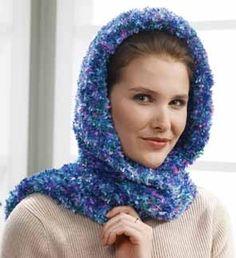 Follow this free knit pattern to create a hooded scarf wrap using Bernat Boa eyelash yarn.