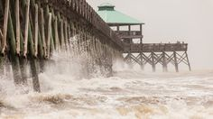 Strong waves batter Folly Beach Pier in South Carolina as Tropical Storm Beryl brushes past the coast on Sunday, May 27, 2012. The storm caused local beaches to restrict Swimming due to strong currents and rip tides. Power outages were reported as well.