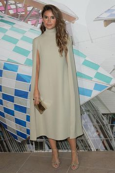 Miroslava Duma's chic outfit wearing a cape style dress, str ...