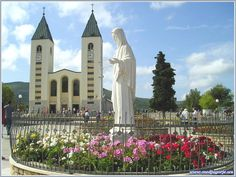 Statue of Queen of Peace and St. James Church - Photos from Medjugorje