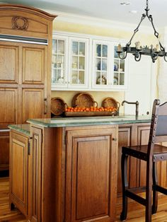 If you don't want to paint the entire room, consider painting just a section of cabinets. For instance, painting three or four cabinets on a short run will create the illusion of a built-in hutch.