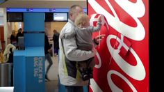 """Brand: Coca Cola Coca Cola has discovered that within their logo, there is a hidden flag that belongs to Denmark - named the happiest country in the world. Coca Cola's slogan is """"Open Happiness"""". Therefore, they made this creative outdoor ad at Copenhagen Airport in Denmark and let Coca Cola and Denmark spread happiness together. The ad had a successful viral effect and enforced the image that Coca Cola want to project."""