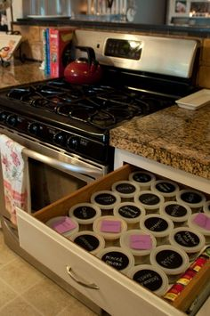 This makes soooo much more sense than a spice cupboard!! The drawer to the right of my cooktop is available and I am going to do this!! Hurray for minutes saved when not digging through the spice cabinet! :D