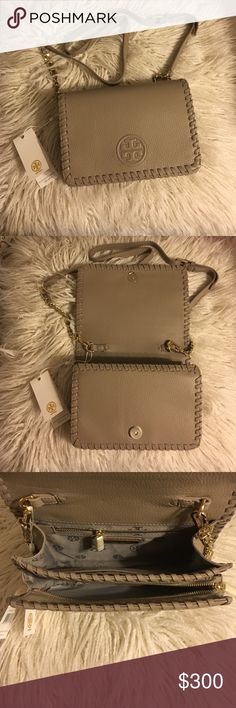 """Tory Burch Marion Combo Cross body Tory Burch Marion Combo CrossBody in French gray!  DETAILS: * Holds a small wallet, a phone, lipstick and a makeup compact * Flap with magnetic snap closure * Adjustable, removable cross-body strap with 23""""  drop * 1 exterior zipper pocket under flap * 1 interior zipper pocket,2open pockets * Height: 5.98""""  * Length: 8.61""""  * Depth: 2.51""""  * Pebbled leather No trades No lowballing ✅Bundle Discount  Authentic items  ✨purchase at listed price get a free…"""