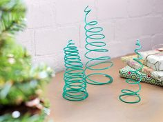 Whip up these springy mini trees to add a playful holiday touch to any area of your home, either indoors or out. Just wrap plastic-coated wire (available at your local hardware store) around craft-store foam topiary forms then pull out the form and voila — instant Christmas tree.
