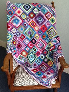 I based this on the Summer Garden Granny Square pattern, but added some larger squares and an edging of shells. It took over a year to complete! I was very excited when my blanket appeared in issue...