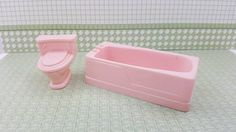 French Provencal soft plastic toilet and bath tub.In very good condition.Called the larger 1/2 scale furniture.Signed Marx. no cracks or breaks. The toilet is 1 and 1/2 high by 1 and 1/4 wide by 1 and 1/2 deep. The bath tub is 3 and 1/4 long by 1 and 1/4 wide by 1 tall. All items come from a smoke free environment. All shipping is calculated by weight and size. I combine shipping as well. Any over payment will be refunded. Shipped from Canada. Keep Etsy a great...