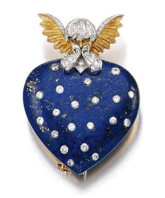 A lapis-lazuli and diamond brooch by Verdura in the form of a love heart with a putto/Cupid figure above.