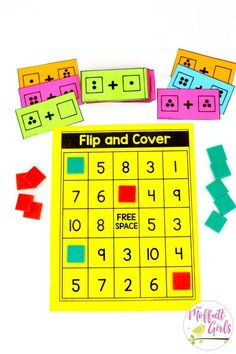 Flip and Cover- such a fun math game! Plus, MORE hands-on addition math centers for Kindergarten! Teach basic addition in a variety of ways that help students build math skills. #mathgames #mathforkindergarten
