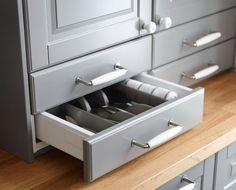 Open above-counter drawer revealing cutlery