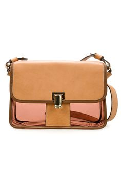 This leather messenger is great for fall, but the vinyl bottom is a playful, summery touch.