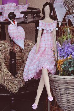 Tilda- cute pom poms on the dress!