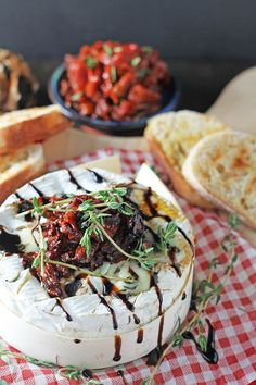 Baked Camembert stuffed with Black Garlic & Thyme and topped with Balsamic Sun-Dried Tomatoes. Ready in less than 20 minutes.