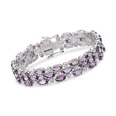 This bracelet showcases 17.50 ct. t.w. of glimmering amethysts, punctuated with twinkling diamond accents, in a glamorous multi-row design. Bracelet is presented in…
