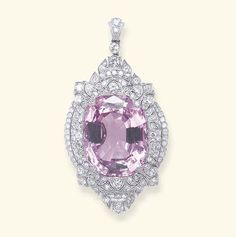 A BELLE EPOQUE PINK TOPAZ AND DIAMOND PENDANT   Of navette-shaped outline, the pierced single and old Euoropean-cut diamond foliate and scroll plaque, centering upon a cushion-cut pink topaz, suspended by a diamond collet, from a single-cut diamond bail, mounted in platinum, circa 1910