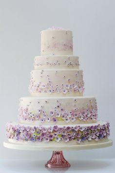 So lovely! Ombre purple flowers on a layered wedding cake #wedding #weddingcake #cake #gardenparty #floral