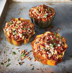 Black-Eyed Pea-Stuffed Acorn Squash | Cutting the squashes crosswise instead of from top to bottom is easier, and they take up less space in the baking dish. Trim the ends so the halves sit flat and don't wobble.
