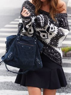 Annette Haga is wearing a black and white knitted sweater from Free People, black skirt from Topshop and the bag is from Balenciaga