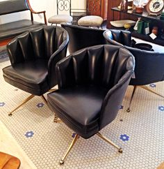 """Mid Century Modern Black Swivel Club Chairs   Two pairs of black vinyl swivel base club chairs with brass metal bases. Each chair is 29"""" tall @Beverly Kaine, 17""""@Christa Schreibeis Sohngen, and 24"""" wide at arms. They are priced in two sets of two, $350/Pair.    Rocket Century  - St. Louis, MO"""