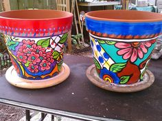 $5 clay pots from Ikea. I hand painted them with heavy body acrylics then sealed them.