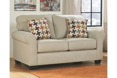 Talk about fine lines and great curves. That's the beauty of the Caci loveseat—made to please your eye for clean, contemporary style. Plush back cushions, lovely rolled arms and a fresh and highly versatile upholstery choice make it a fashion statement that'll suit you for years to come.