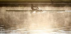 A rower is seen on the River Thames as the sun rises in Henley-on-Thames, southern England April 21, 2015. REUTERS/Eddie Keogh