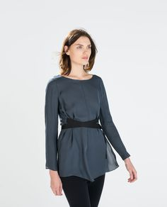 ZARA - DAMEN - STUDIO-TOP AUS SEIDE MIT BÄNDERN. Silk studio top with ribbon strips. 79.95 €, grey. 100% mulberry worm silk. Not machine washable. (Three questions: Opaque enough to wear without a top underneath? Fabric easy to care for? New silk purchase unethical because of worms' demise during manufacture?)