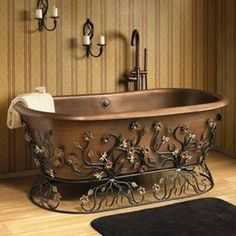 Copper bathtub with wrought iron stand