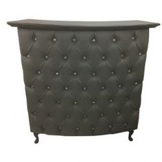 Small curved reception desk with grey faux leather padded front